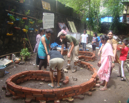 The residents of Kores Housing Society in Mumbai lay the foundation for a community garden in their backyard