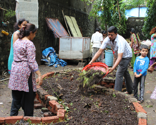 Then, the residents put a layer of compost over the organic waste matter